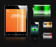 Tablet, mobile phone and batteries Stock Image
