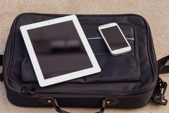 Tablet and mobile phone on a fashionable  bag. Copy space. Outdo Stock Image