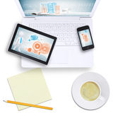 Tablet and mobile phone on laptop with coffee cup Royalty Free Stock Images