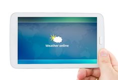 Tablet with mobile weather forecast app Royalty Free Stock Photography
