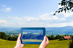 Tablet - Mountain landscape. Girl Tablet and Mountain landscape Royalty Free Stock Photo