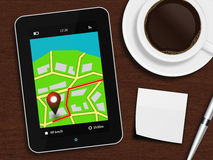 Tablet with navigation application, cup of coffee, pen and white Royalty Free Stock Images