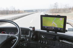 Tablet with navigation in truck cabin during drive royalty free stock photos