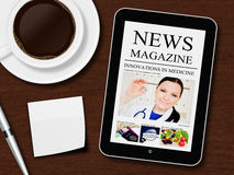 Tablet with news magazine, cup of coffee, pen and white sheet Royalty Free Stock Photo
