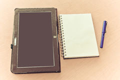 Tablet notebook and pen Stock Photography