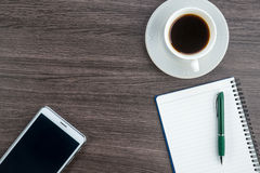 Tablet, notebook and pen with a cup of coffee Royalty Free Stock Photography