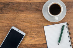 Tablet, notebook and pen with a cup of coffee Stock Image