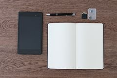 Tablet, notebook, pen and SD cards. Setup of a workspace for a j stock photo