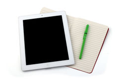 Tablet notebook and pencil. Set of shut down tablet, white lined notebook and green pencil Stock Photos