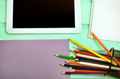 Tablet with notepad and colorful pencil Royalty Free Stock Photo