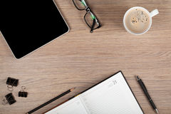 Tablet, notepad, glasses and coffee cup Stock Photography