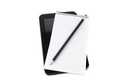 Tablet with notepad Royalty Free Stock Images