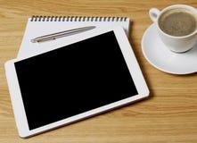 Tablet, Notizbuch und Kaffee Stockbild