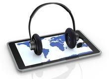 Tablet och hörlurar Arkivbild