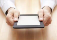 Tablet oder eBook Leser in den Händen Stockbild