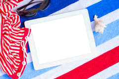 Tablet On Beach Towels With Sunbathing Accessories Royalty Free Stock Image