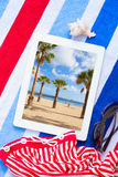 Tablet On Beach Towels With Sunbathing Accessories Stock Photo