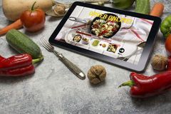 Tablet with Online food delivery app on screen. lifestyle concep Stock Image
