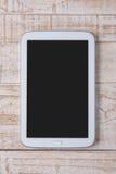 Tablet op wit hout voor het werk en achtergrond Royalty-vrije Stock Foto's