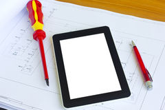 Tablet over engineering diagram stock photos