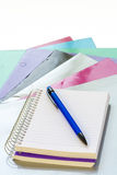Tablet of paper and a pen ready for writing Royalty Free Stock Images