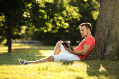 Tablet in park Stock Image