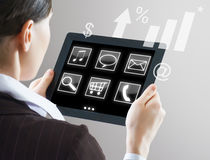Tablet pc. A woman holding a tablet pc Stock Images