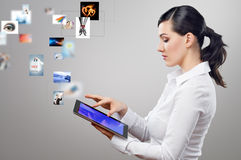 Tablet pc. A woman holding a tablet pc Stock Photos