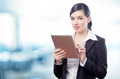 Tablet pc. A woman holding a tablet pc Royalty Free Stock Photos