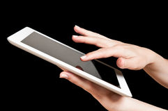 Tablet PC. Hands holding and touching a tablet pc Stock Photography