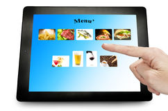 Tablet pc. Man hand touching on a tablet pc Royalty Free Stock Image
