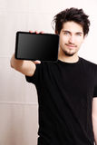 Tablet PC. A young hispanic man holding a Tablet PC Stock Image
