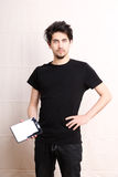 Tablet PC. A young hispanic man holding a Tablet PC Royalty Free Stock Image
