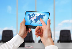 Tablet pc with air travel plan. Hand holding digital tablet pc with air travel plan Royalty Free Stock Photos