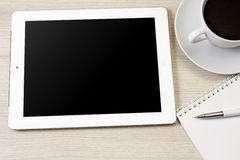 Tablet pc. Alike ipad with blank screen and pen over table, notepad Royalty Free Stock Image