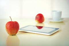 Tablet pc with apple Royalty Free Stock Photos