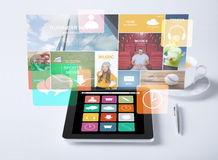 Tablet pc with application icons and cup of coffee Royalty Free Stock Photography