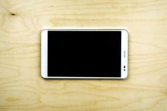 Tablet-PC auf hölzernem Hintergrund Stockfoto