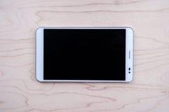Tablet-PC auf hölzernem Hintergrund Lizenzfreies Stockfoto
