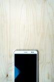 Tablet-PC auf hölzernem Hintergrund Lizenzfreie Stockfotografie