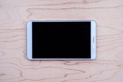 Tablet-PC auf hölzernem Hintergrund Lizenzfreie Stockbilder