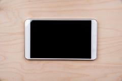 Tablet-PC auf hölzernem Hintergrund Lizenzfreies Stockbild