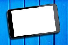 Tablet-PC-Auflagen-Blau-Holztisch des leeren Bildschirms Stockfotos