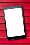 Tablet-PC-Auflagen-Rot-Holztisch des leeren Bildschirms Lizenzfreie Stockbilder