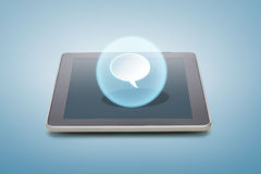 Tablet pc with bank text bubble icon over screen Stock Photo