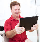 Tablet PC in Bathroom Royalty Free Stock Photo