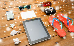 Tablet pc and beach stuff Stock Photo