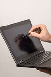 Tablet pc is being used with a pen royalty free stock photography