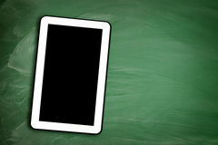 Tablet pc and blackboard green Stock Images