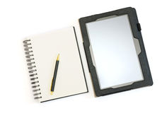 Tablet pc and a blank notepad with a pen Stock Image
